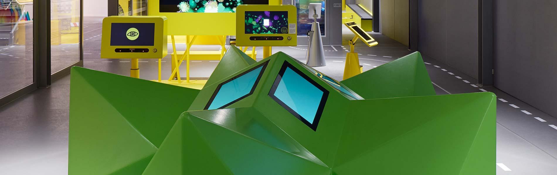 Grön flerformig musikmaskin